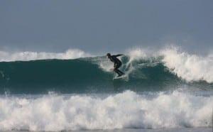 Castlegregory Surfer on the Wild Atlantic Way by Valerie O'Sullivan